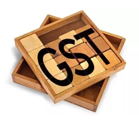 Image That Depicts The GST Concept - GST Text Written On Wooden Blocks.