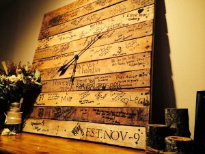 Love my guest book! Pallet wood, clock, sign, guest book for wedding.